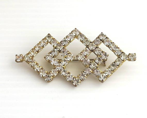 Large mid 20th century Art Deco style rhinestone brooch with 3 intersecting diamond shapes, clear rhinestones, gold plated setting