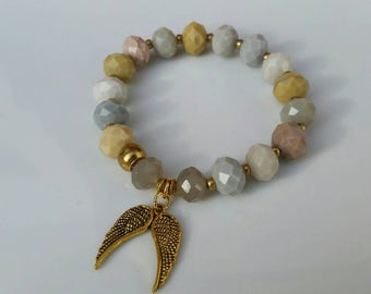 Angelic...neutral colored  czech crystals with angel charm  bracelet.