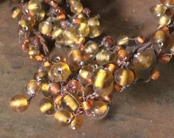 Vintage glass beaded garland wire garland vintage glass beads vintage amber beads