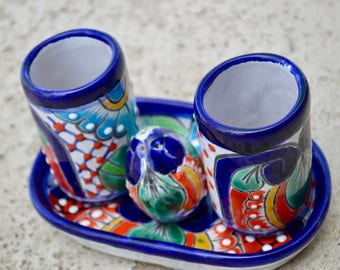 Set of tequila glasses with salt shaker