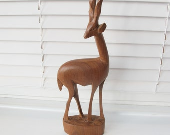 Vintage wooden deer or gazelle.