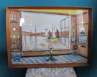 Vintage original artwork - framed painting of an interior looking out at a harbour with lighthouse and boats.