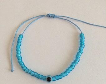 Light blue seed bead bracelet with evil eye