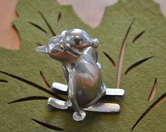 Aluminum penguin skiier - I just think he's cute!!