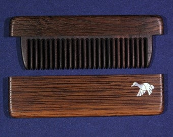 Comb in the case of heat-treated ash with inlaid mother of pearl - duck