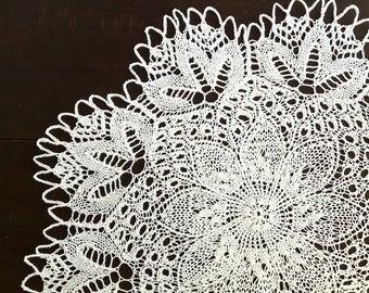 White handmade knitted round doily