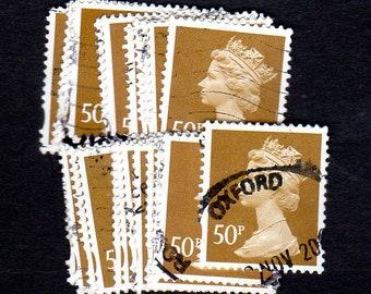 25 used Vintage Ocher G.B. Postage Stamps