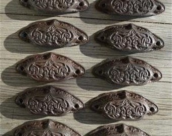 A set of 10 Eastlake style cast iron drawer pulls AL13