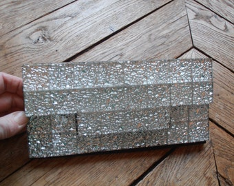 A vintage glass-covered clutch purse