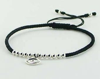 Sterling silver and waxed cotton macrame bracelet with evil eye charm