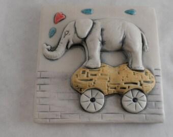 Elephant riding a peanut - high relief ceramic tile