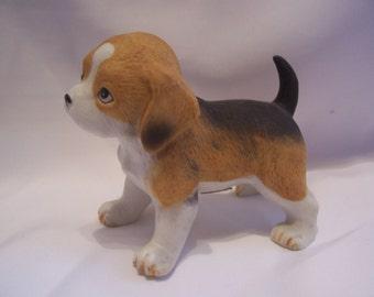 Three Assorted Dogs Figurines