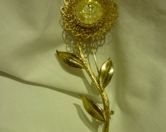 A46 Ornate Gold Tone and Iridecent Plastic Flower Pin.