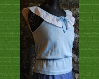 "1970's light blue jersey tank with embroidered white peasant ruffle and elastic waist.   Bust 36""  By Bronson"