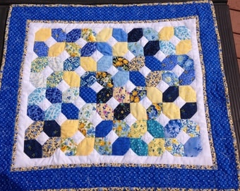 Small quilted yellow and blue wall hanging