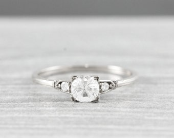 White sapphire and diamond engagement ring handmade in 14 carat white gold art deco inspired