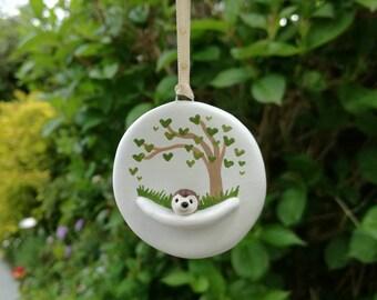 Miniature hedgehog ornament. Little pottery hedgehog hanger. Hand painted tree