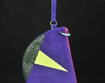 purple suede clutch