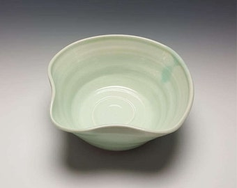 Handmade ceramic bowl by Potteryi. Celadon mixing bowl with a spout.