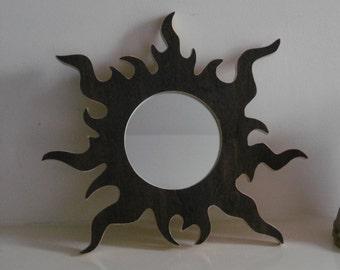Black sun mirror