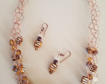 Copper wire and candy look bead necklace and earrings.