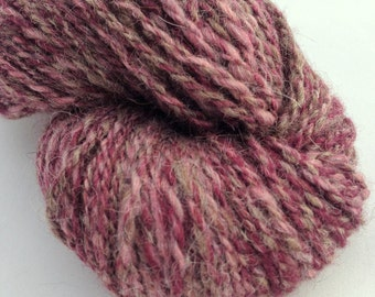 Hand Spun Wool, Alpaca and Mohair.  Worsted Weight.  Wine, pink brown colors. ~165 Yards.  Great for knitting, crocheting or weaving