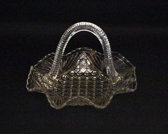 Vintage glass present dish with handle-press glass handle-scale