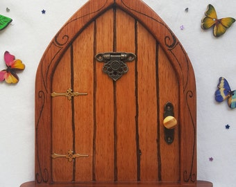 Wooden Fairy Door, Handmade with oak, patterned frame, with moving door knocker, also includes Butterflies and Fairy Dust