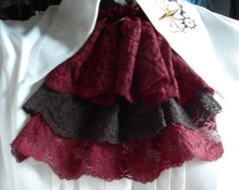 coin pendant and brown/red lace jabot
