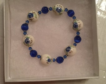 Blue flowered bracelet with blue cats eye spacing, hand made