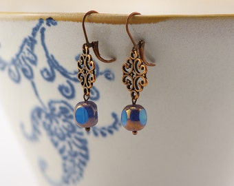 copper earrings with ornament and blue copper Pearl