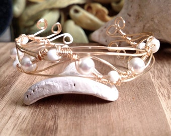 Gold plated wire wrap bangle with white pearl beads and seed beads
