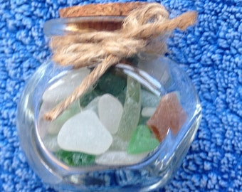 Little glass jar filled with sea glass
