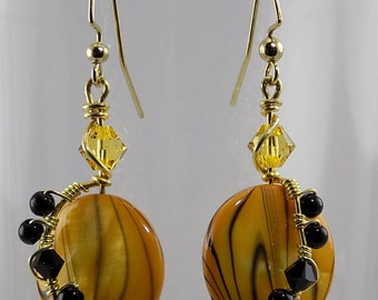 Bright yellow with black beads, very unique!
