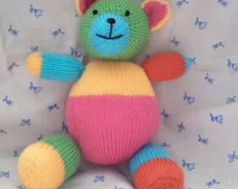 Multi coloured knitted bear