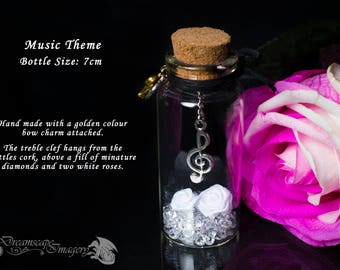 Small handmade miniature message in a bottle music theme