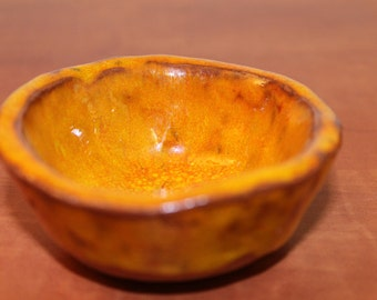 orange small cup or bowl