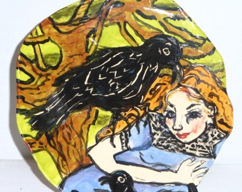 plate ceramics and pottery girl and crow figurative plate black crows blue green brown black decorative plate