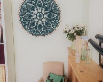Intricate crochet doily wall art, pineapples, yarn and a hula hoop!