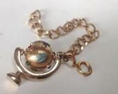 World Globe Queen Mary Souvenir Mechanical Charm Bracelet – 1960s Jewelry