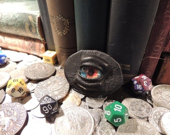 Dragon eye Brooch (Black leather with Blue/Orange Eye)