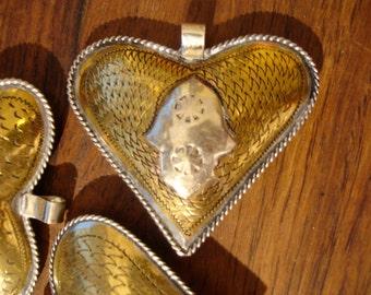 Moroccan  hand made medium brass heart hollow pendant + silver colour hand