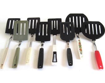 Plastic Spatulas: Ekco Round Pancake Turner, Ekco Short Handle, Koco Japan, Hoan, Orange Handle Korea, or Unmarked Black Plastic