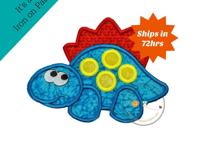 Happy, blue-crackled stegosaurus with bright yellow spots and red razor back. Dino rimmed in matching blue, red, and bright yellow thread.