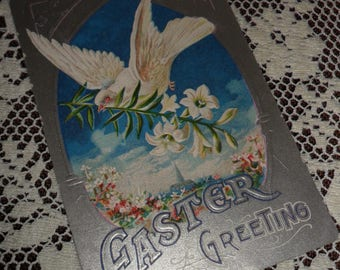 Antique Vintage Victorian Easter Greeting Embossed Postcard Early 1900s Dove of Peace with an Easter Lily Blue Sky Silver background