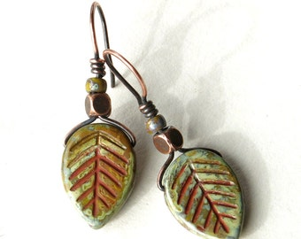 Leaf dangle earrings - green leaves Picasso Czech glass & antiqued copper beads
