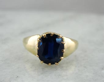 Cushion Cut Blue Sapphire Solitaire Ring in Yellow Gold with Multi Pronged Head, Bold Gold Shoulders V063A9-N