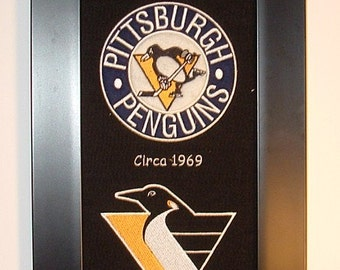 Pittsburgh Penguins Heritage Team Banner....Framed