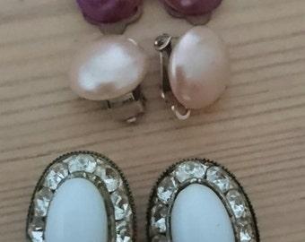 Five pairs of vintage clip on earrings
