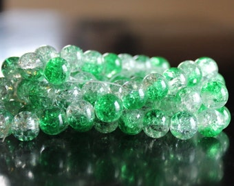 80 approx. green and clear, 10 mm crackle glass beads, 1.5 mm hole, round and smooth, light reflective